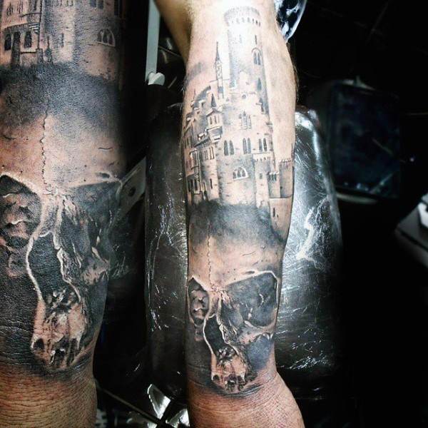 Accurate designed black and white medieval castle with skull tattoo on arm
