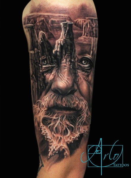 Accurate designed black and white very detailed old wizard tattoo on shoulder with ancient ruins