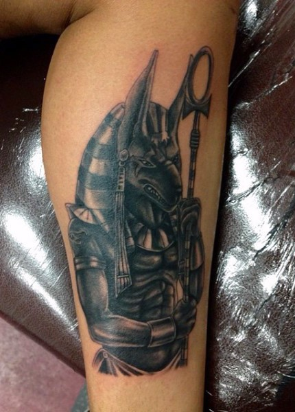 Accurate detailed black and white leg tattoo of Anubis God