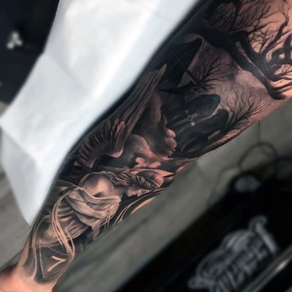 Accurate detailed colored horrifying cemetery tattoo on sleeve with angel statue and lonely tree