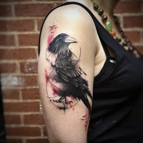 Accurate lifelike colored upper arm tattoo of crow