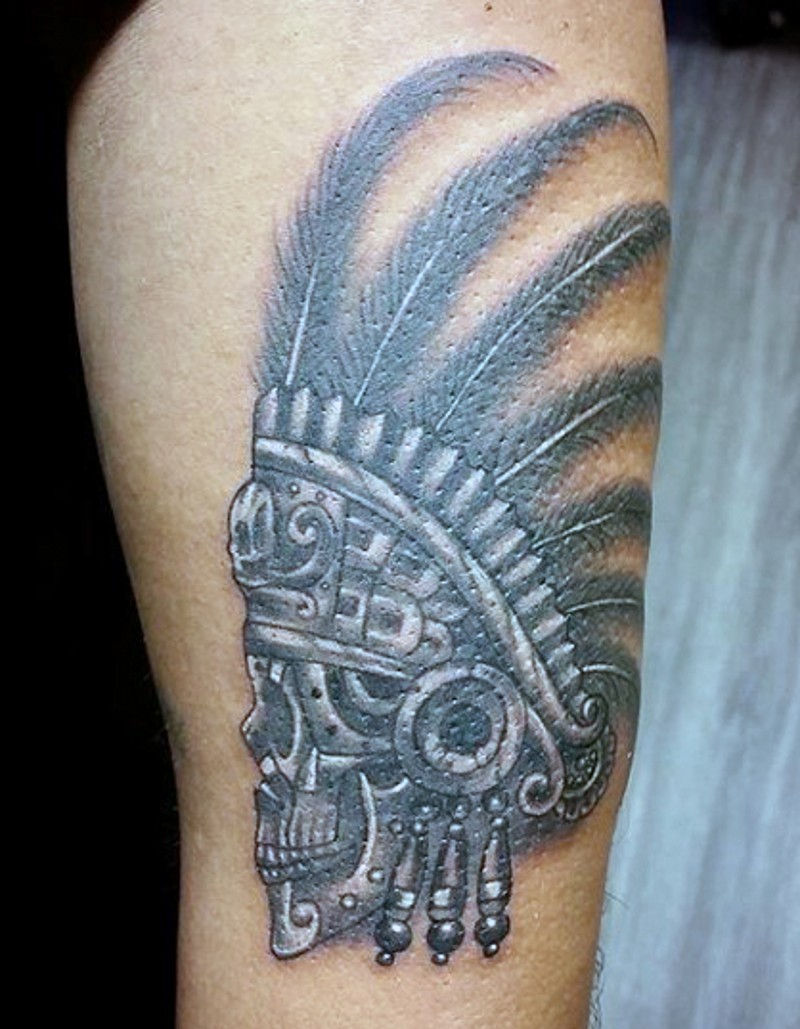 Accurate looking black and white thigh tattoo of tribal skull