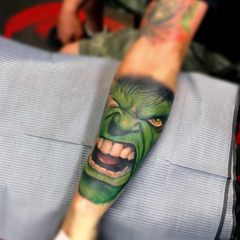 Accurate looking colored forearm tattoo of big green Hulk head