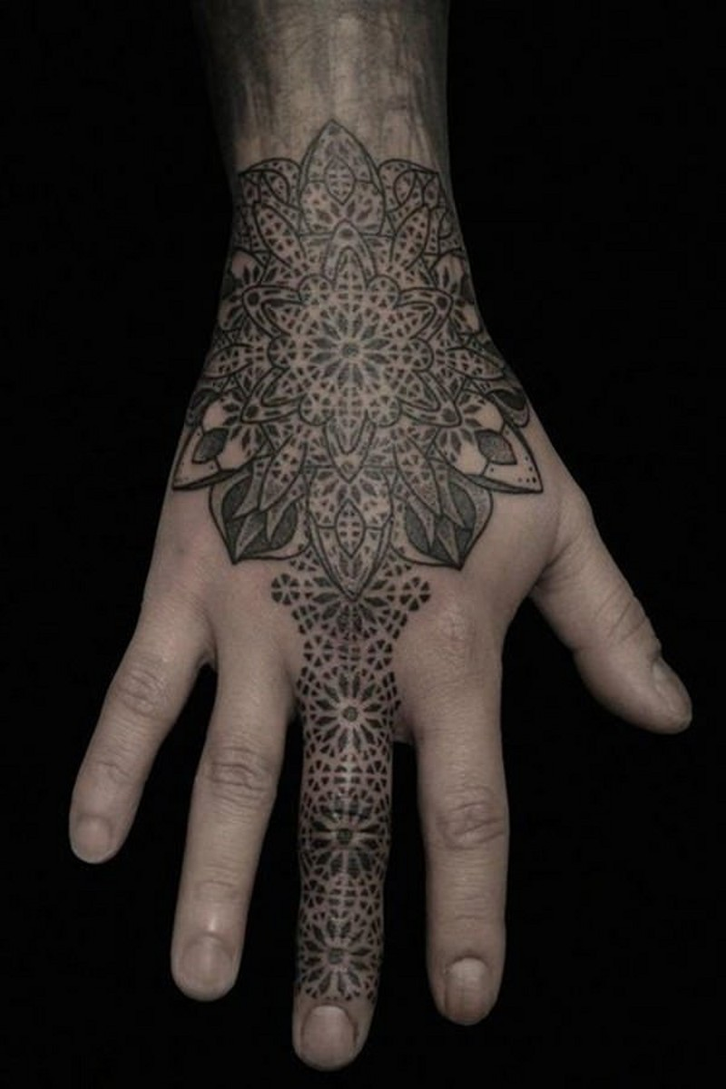 Accurate looking colored hand and finger tattoo of ornamental flower