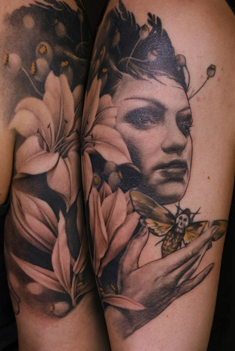 Accurate looking colored woman portrait tattoo on shoulder combined with flowers and night butterfly