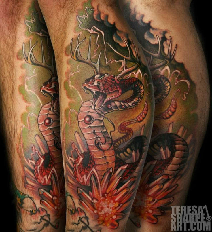 Accurate looking colorful strange snake with deer horns tattoo stylized with crystals