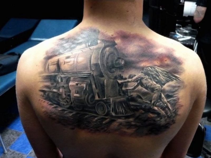 Accurate looking half colored upper back tattoo of train with angels