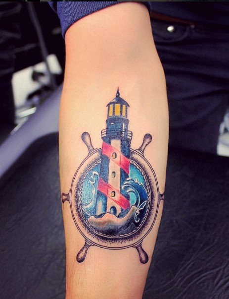 Accurate nice colored fantasy light house tattoo on forearm with ship steering wheel