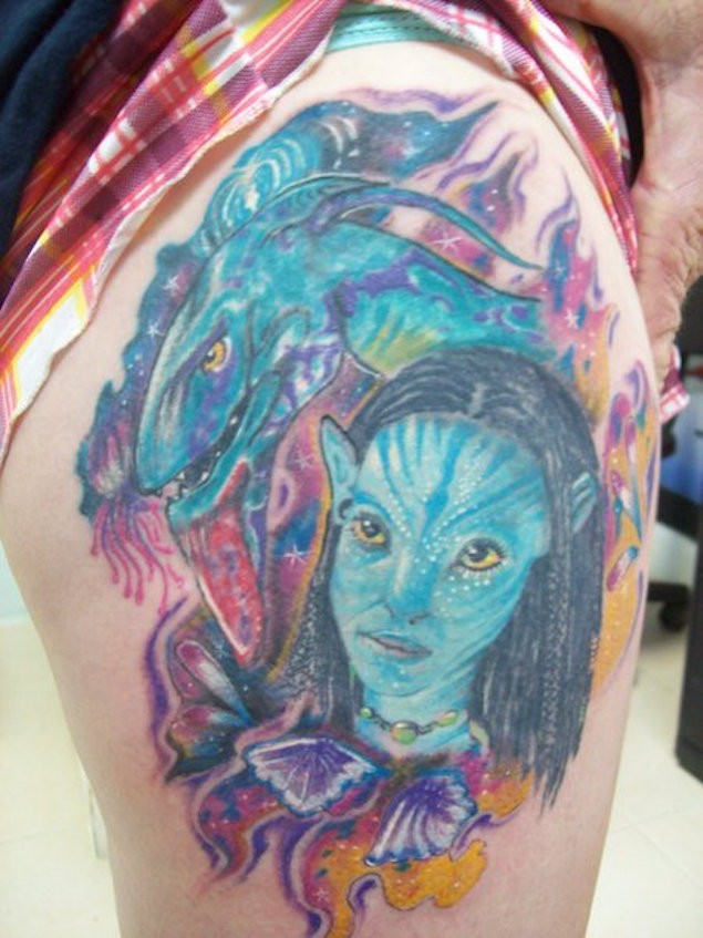 Accurate painted and colored little Avatar heroes tattoo on thigh