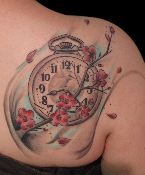 Accurate painted and colored little clock tattoo on back with blooming tree