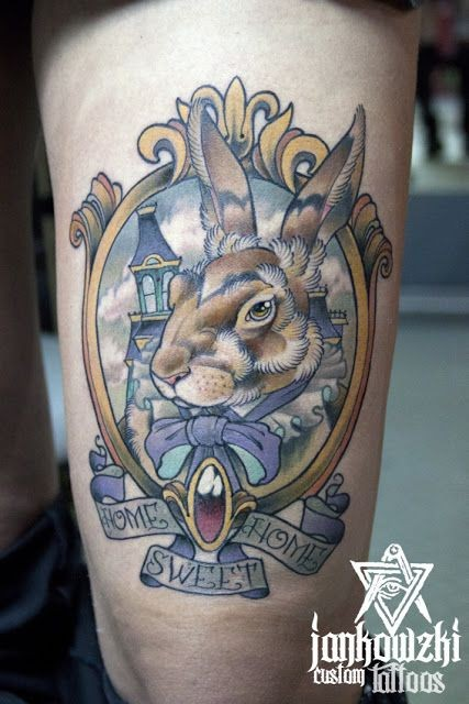 Accurate painted and colored little rabbit portrait tattoo on thigh with lettering
