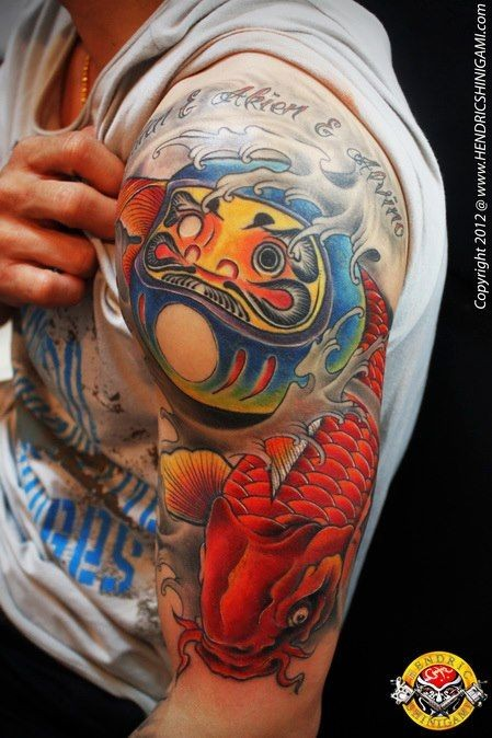 Accurate painted and colored shoulder tattoo of Asian daruma doll with carp fish