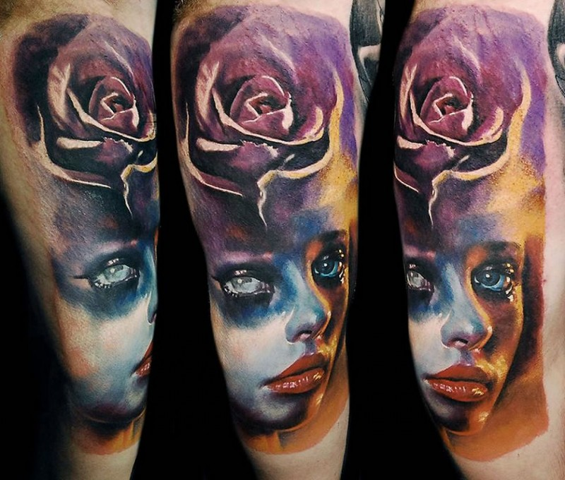 Accurate painted and colored tattoo of woman face stylized with rose