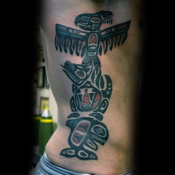 Accurate painted and colored tribal statue tattoo on side