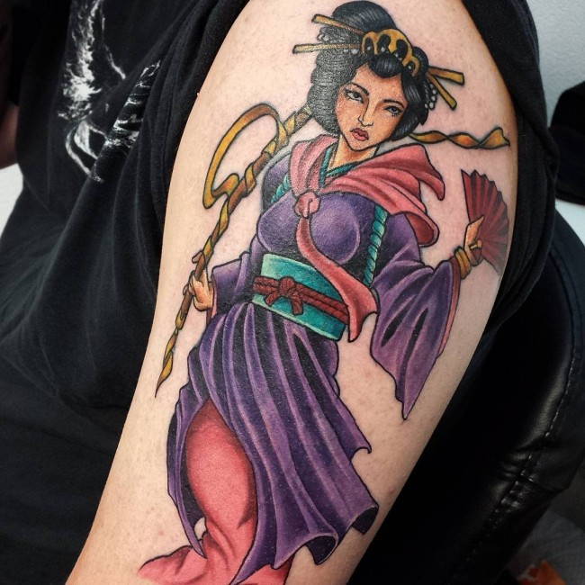 Accurate painted beautiful looking colored shoulder tattoo of Asian geisha