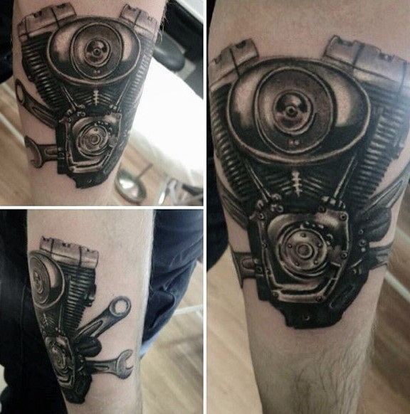 Accurate painted black and white bike engine tattoo on forearm