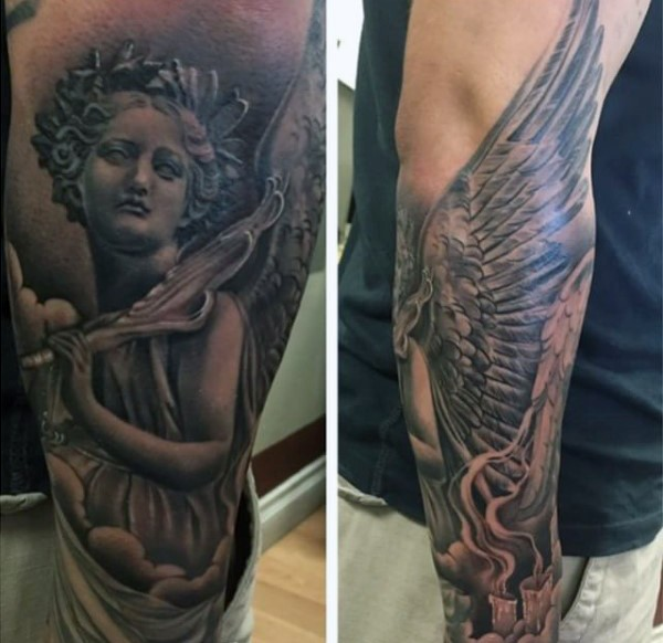 Accurate painted black and white forearm tattoo of angel statue with candles