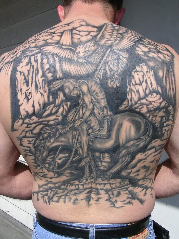 Accurate painted black and white Indian warrior tattoo on whole back with eagle