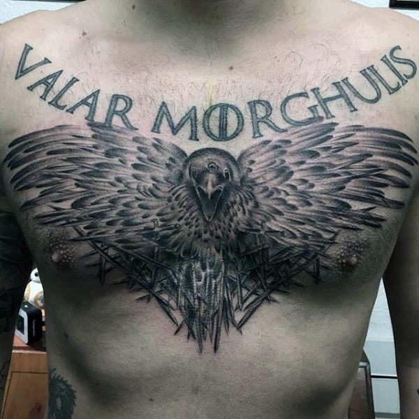 Accurate painted black and white mystic crow with lettering tattoo on chest