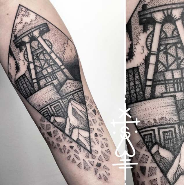 Accurate painted black ink forearm tattoo of old mine