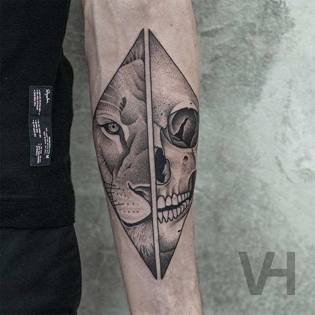 Accurate painted by Valentin Hirsch forearm tattoo of split lion head with