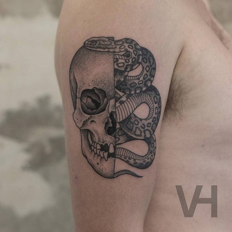 Accurate painted by Valentin Hirsch shoulder tattoo of split human skull with snake