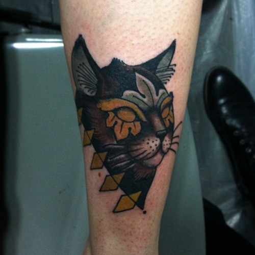 Accurate painted colored arm tattoo of mystical cat head
