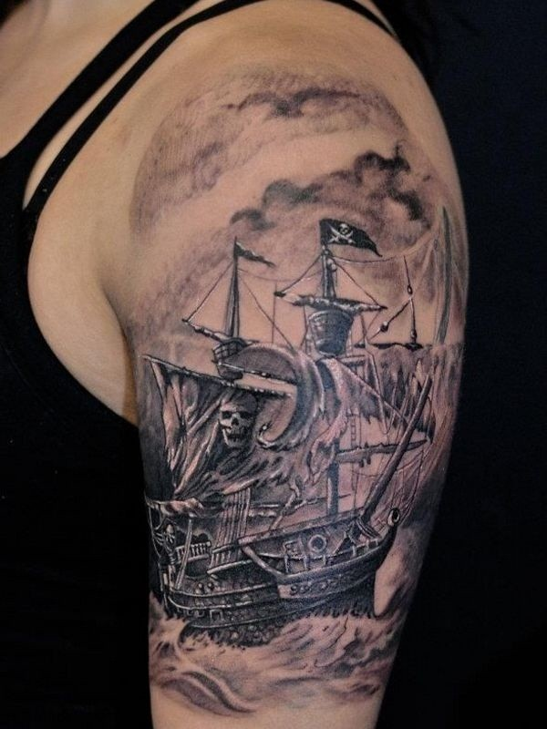 Accurate painted colored creepy pirate sailing ship tattoo on shoulder