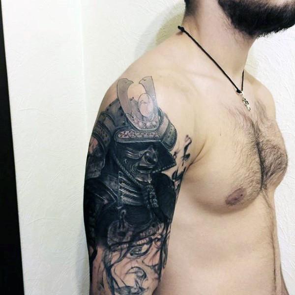 Accurate painted colored mystical dark samurai helmet tattoo on shoulder