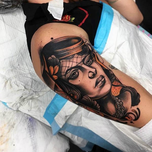 Accurate painted colored vintage woman portrait tattoo on upper arm