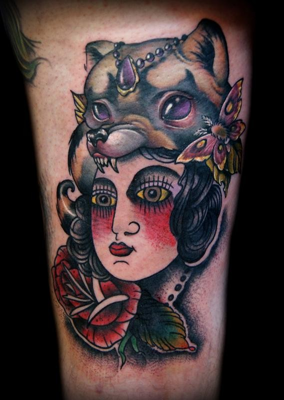 Accurate painted old school colored gypsy witch tattoo on arm stylized with flowers and butterfly