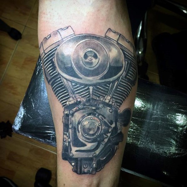 Accurate painted very detailed engine tattoo on arm