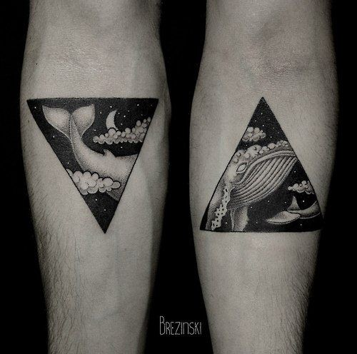 Adorable black triangle style whale forearm tattoo