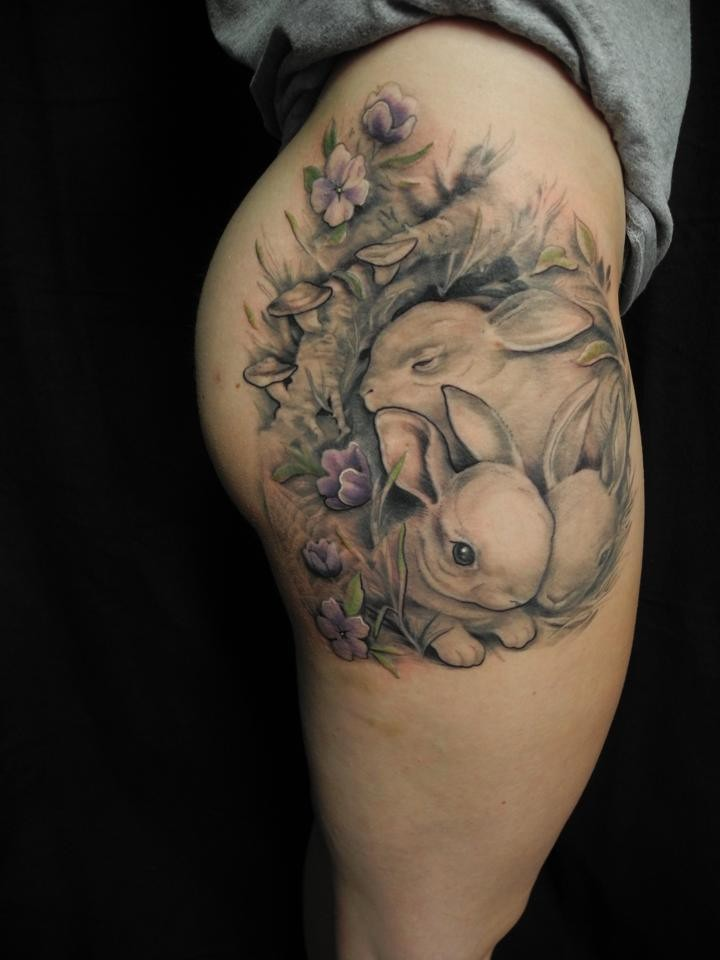 Adorable cute bunnies tattoo on thigh