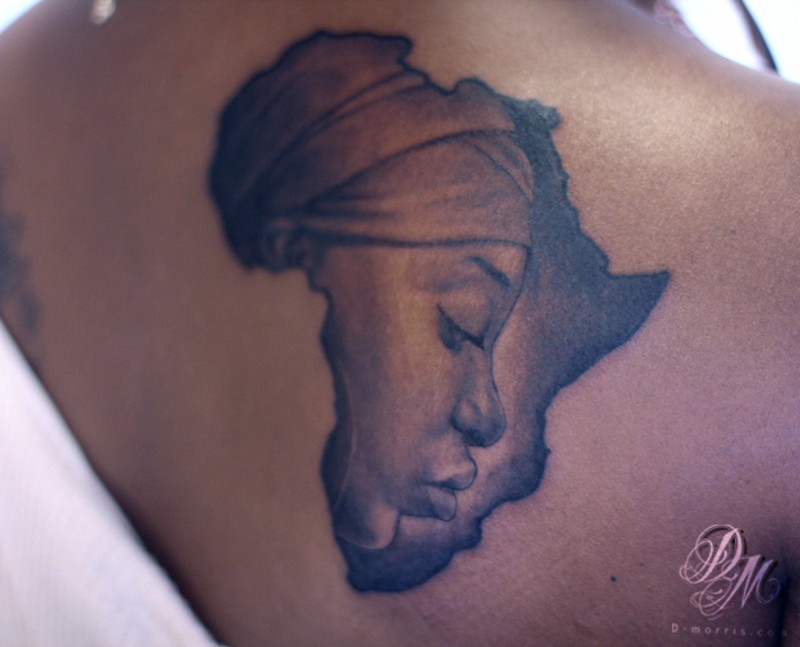Africa continent shaped black ink tattoo on back stylized with woman portrait