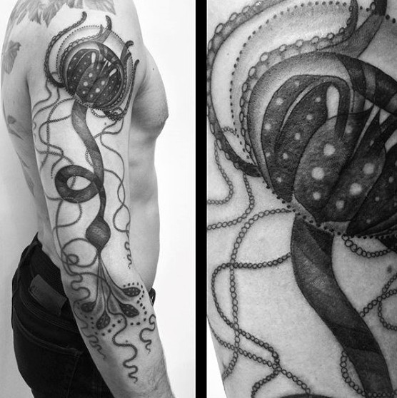Alien like big black and white detailed jellyfish tattoo on sleeve