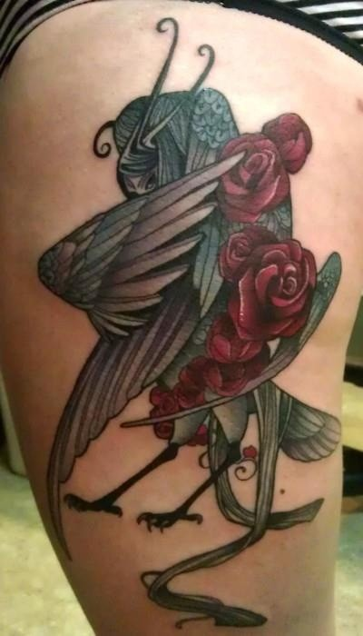 Amazing bird with red flowers tattoo on thigh
