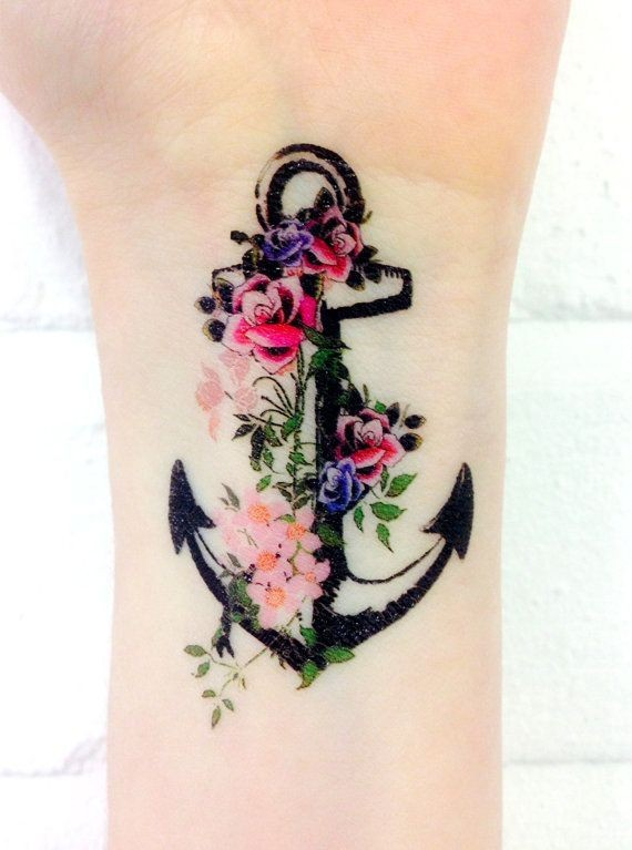 Amazing black anchor with flowers tattoo on wrist