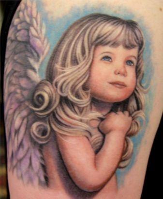 Amazing colorful blonde girl cherub tattoo