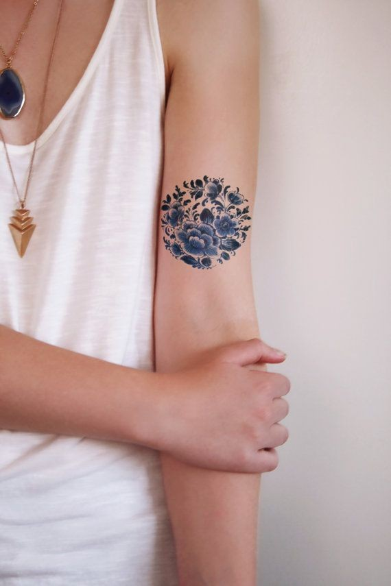 Amazing dark blue flowers tattoo on arm for girls