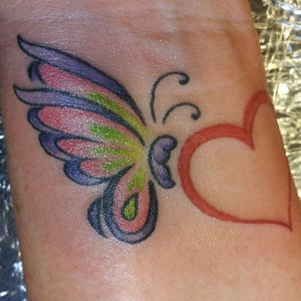Amazing and cute butterfly tattoo on wrist