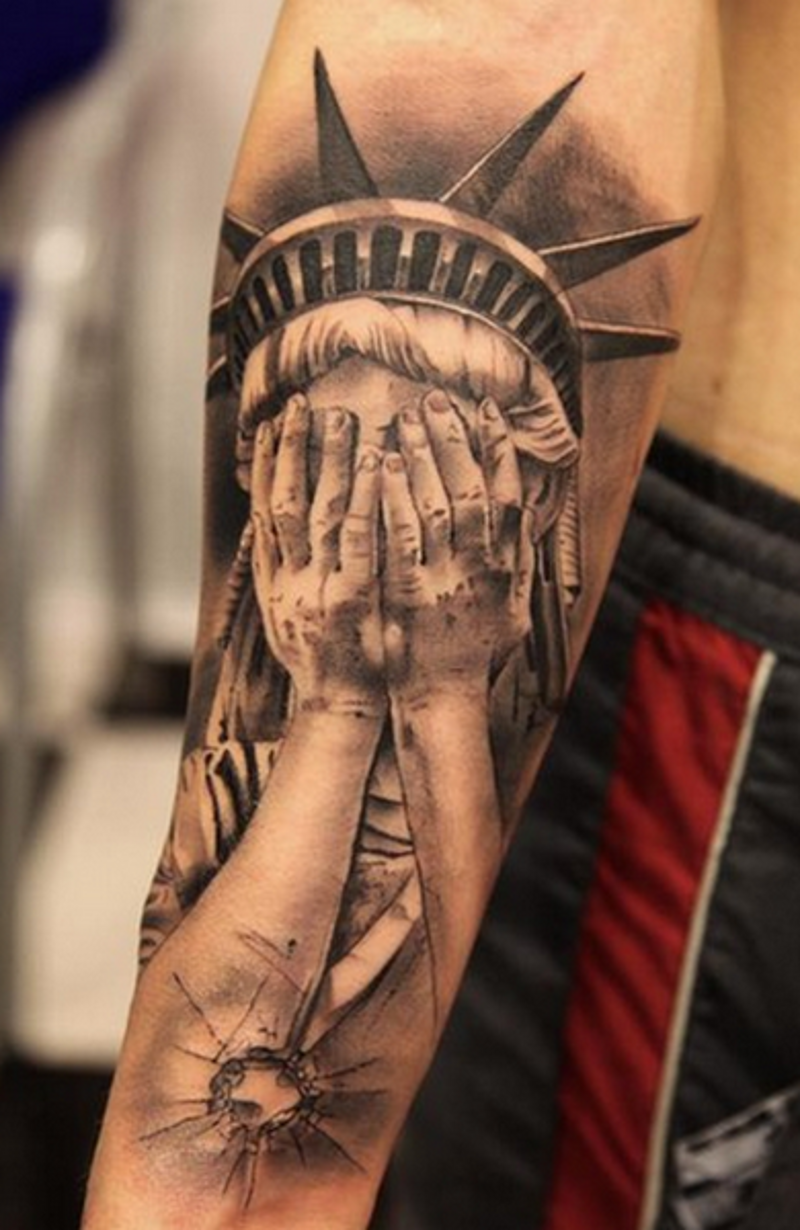 Amazing black and white detailed forearm tattoo of crying Statue of Liberty