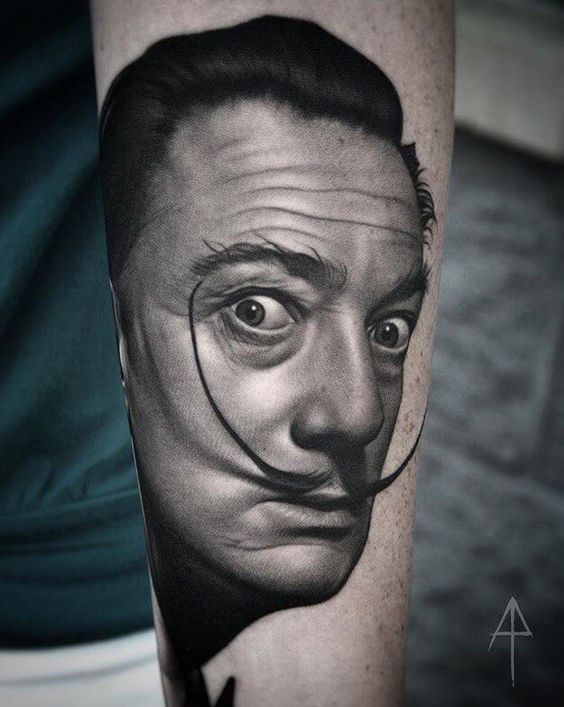 Amazing black grey portrait of Salvador Dali tattoo