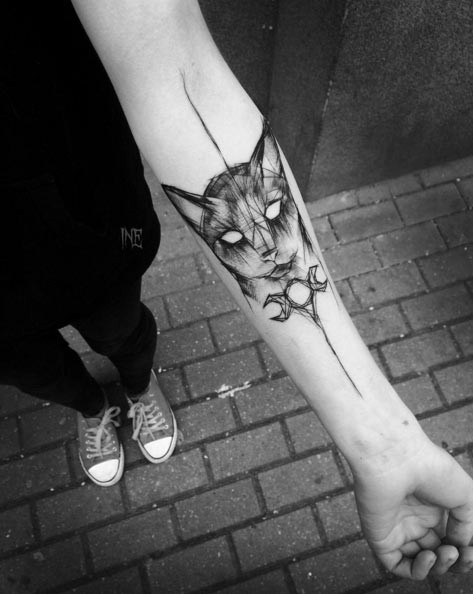 Amazing black ink detailed sketch style cat face tattoo on forearm