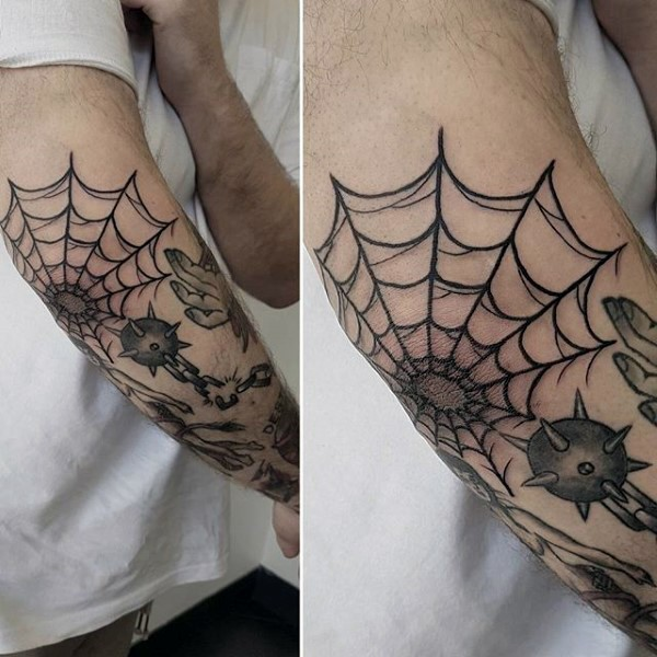 Amazing black ink spiderweb tattoo on elbow in old school style