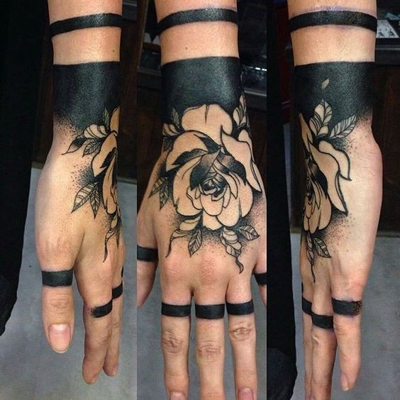 Amazing blackwork style wrist tattoo of detailed rose with black lines