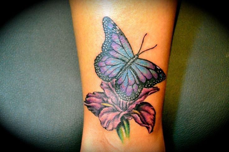 Amazing butterfly wrist tattoo on pink flower