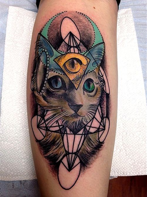 Amazing colored leg tattoo of mysterious cat with eye