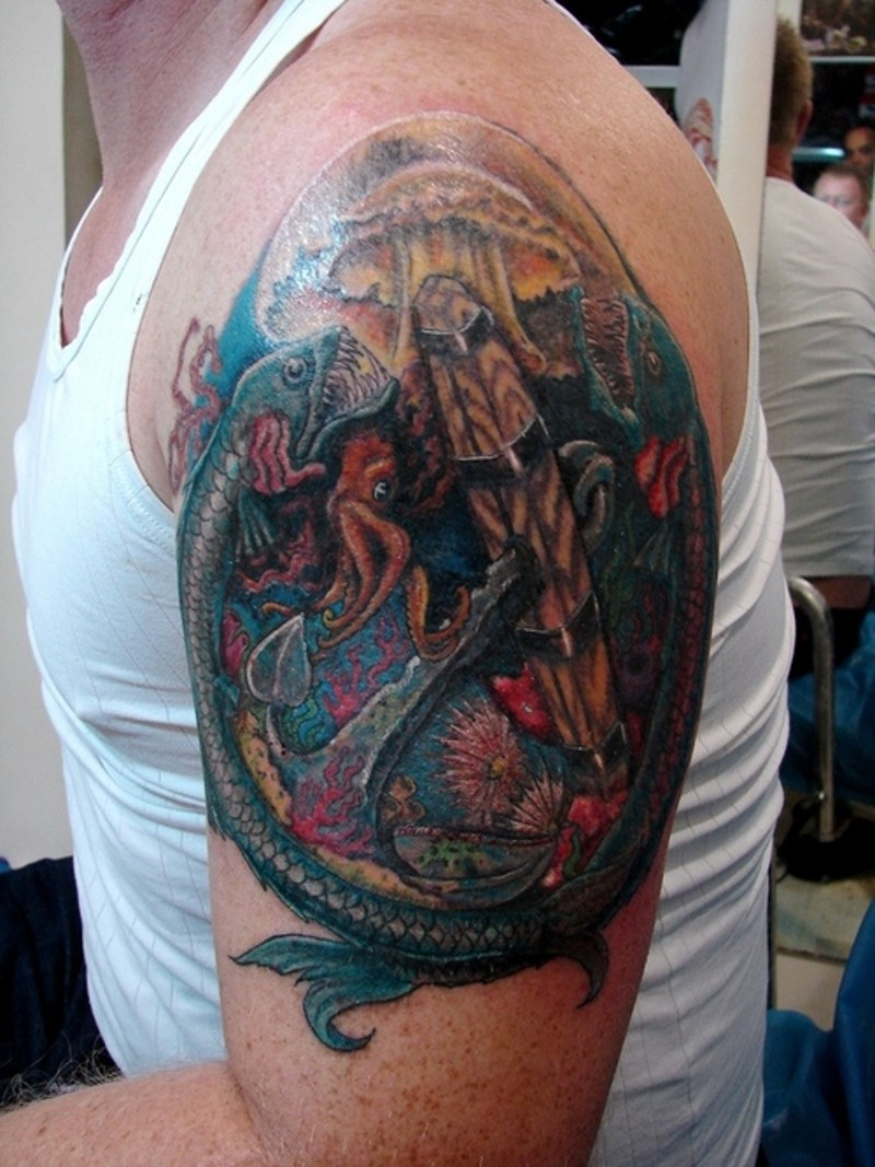 Amazing colored shoulder tattoo of various under water fishes and octopus