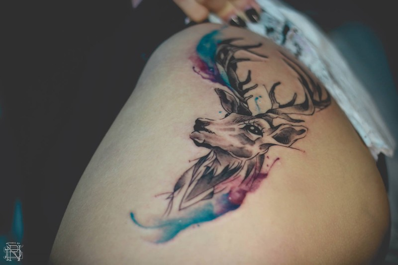 Amazing deer portrait tattoo with colored paint drips in watercolor style